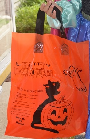 "H3708SL  12"" x 12""  X 4"" Orange Halloween Soft Loop plastic bag with safety messages"